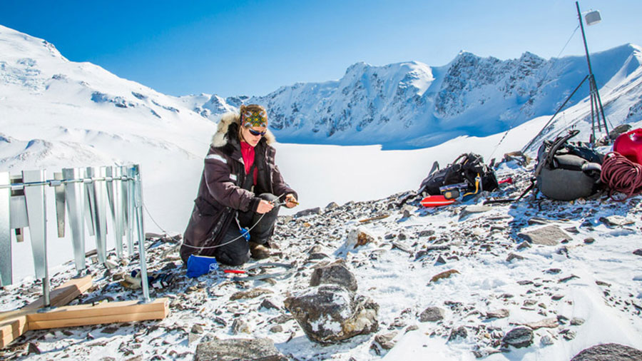 WERC Research Anna Liljedahl working on setting up a monitoring station on Jarvis Glacier
